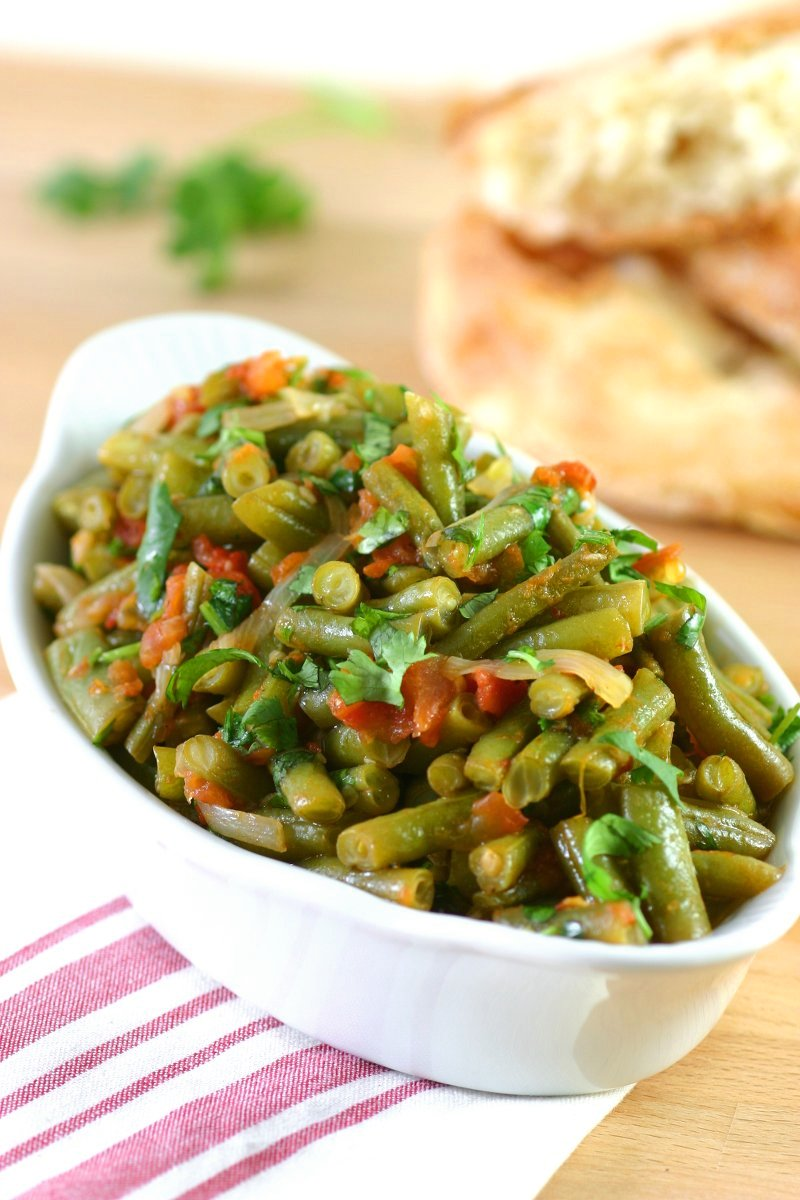 Middle Eastern Stewed Green Beans (Fasoolya bi Zayt) can be a side dish or even a light summer meal when served with lots of pita bread.