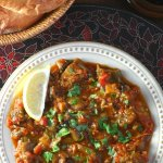 This warm Moroccan Eggplant Salad (Zaalouk) combines cooked eggplant, tomatoes, and classic spices and is enjoyed as a side or alone with lots of bread.