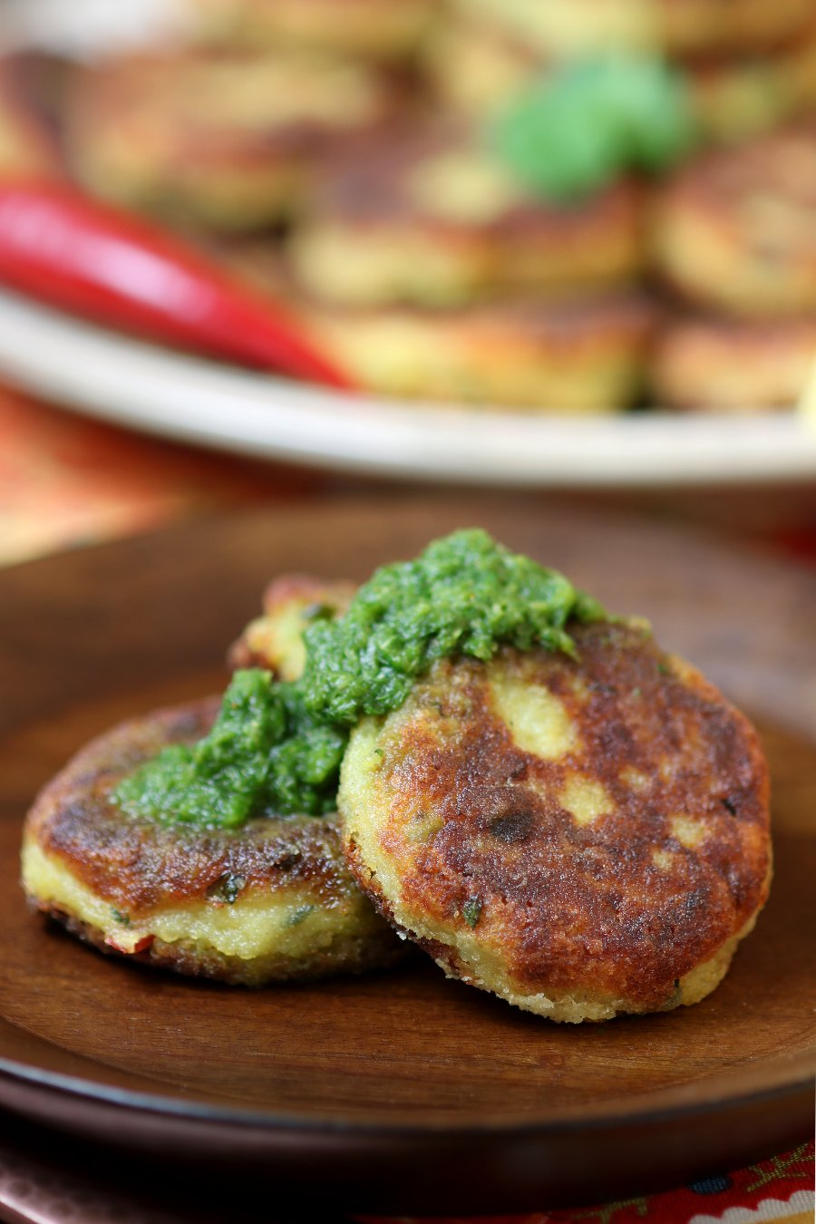 Spiced Potato Patties (Aloo Tikki) are a crisp and tender Indian street food snack that you can recreate in your kitchen.