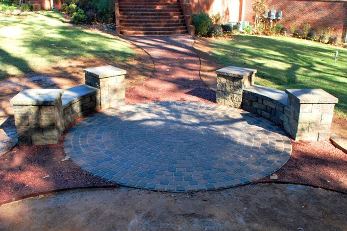 paver patio with bench seat wall