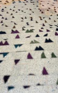 Shadows of flags celebrating the beginning of Ramadan