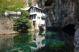 Ottoman House with the Buna River emerging from the cave at Tekke on Buna, Blagaj