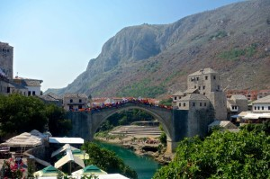 Mostar bridge with students with flags from around the world