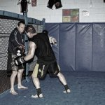 Anthony Lange working the pads against the cage with Ken Shamrock