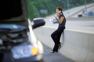 car breakdown and woman on phone