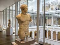 Translation and Localization - Ancient Statue of Man in Museum