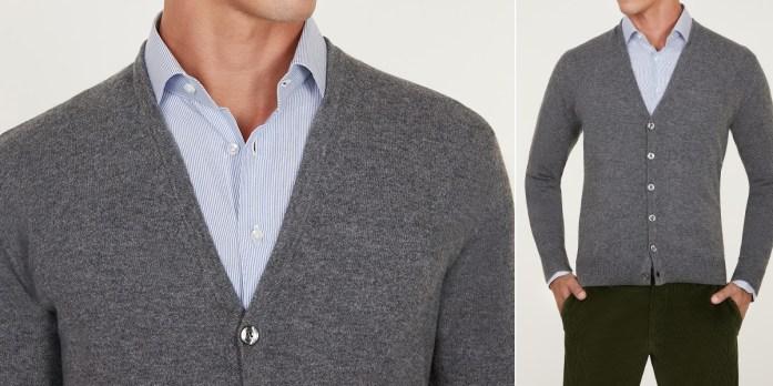 Cardigan grigio scuro indossato su camicia a righe blu e bianche