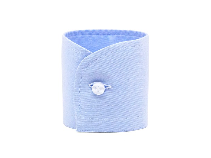 Light blue rounded barrel cuff with white button