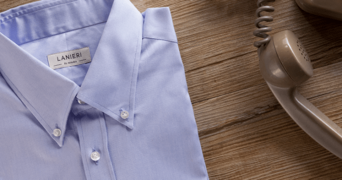 Lanieri's custom blue dress shirt with a button-down collar folded up next to an old '70s phone