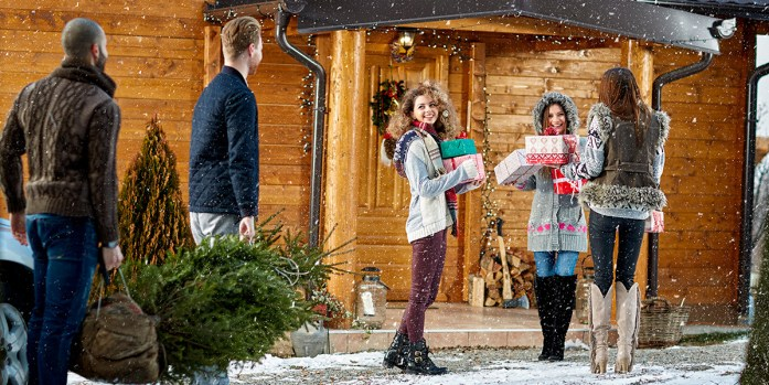 Three girls and two boys celebrate the New Year in a chalet
