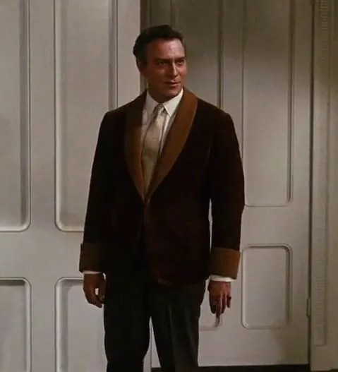 "Actor Christopher Plummer plays Captain Von Trapp in movie ""The Sound of Music"" wearing a ""historical"" version of the tuxedo."