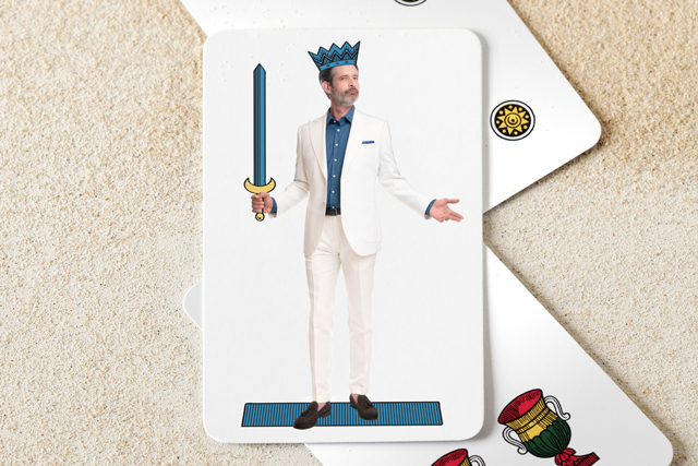 Italian neapolitan playing card: man in white suits dressed as king of swords