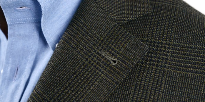 Classic notched lapels detail on a two-button Prince of Wales jacket