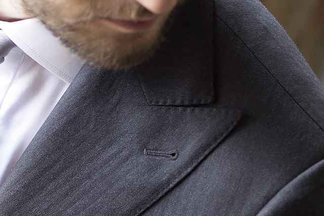 Made to measure gray suit, detail on peak lapel