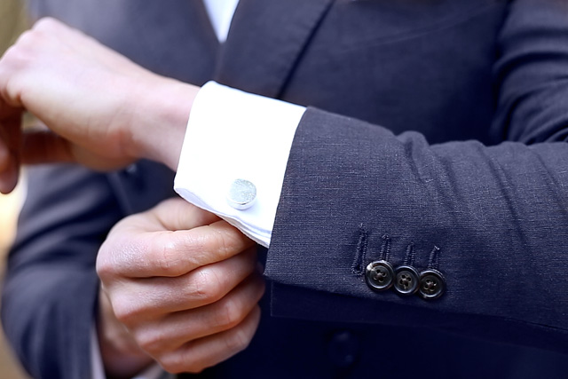 Cuff detail for cufflinks on white tailored shirt for groom