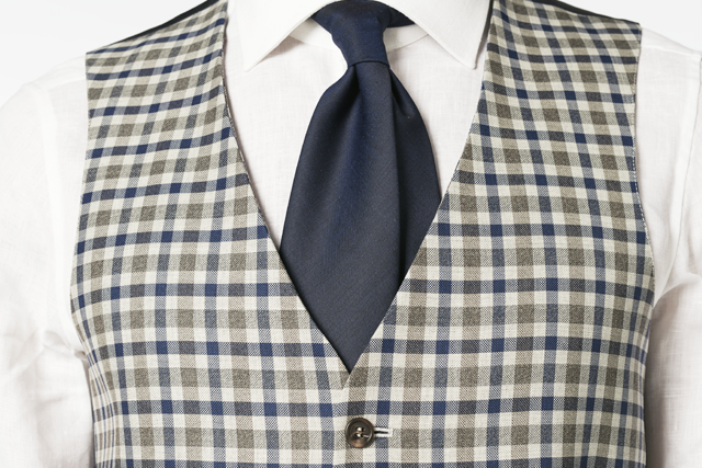 Lanieri's tailored checked waistcoat with matching blue tie and white shirt