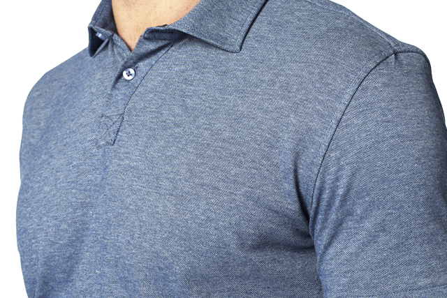 Man wears a tailored light blue polo shirt with made by Lanieri