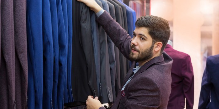 A man looking for ready to wear clothes