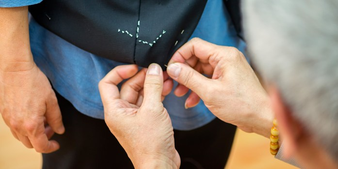 "A tailor is sewing a waistcoat ""sartoriale"""