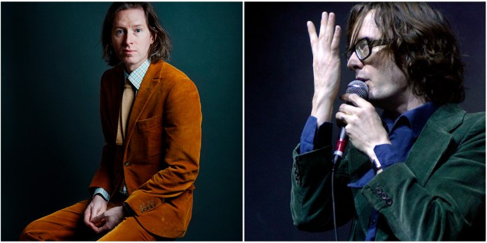 Wes Anderson (left) wears a brown corduroy suit; Jarvis Cocker (right) wears a green corduroy suit