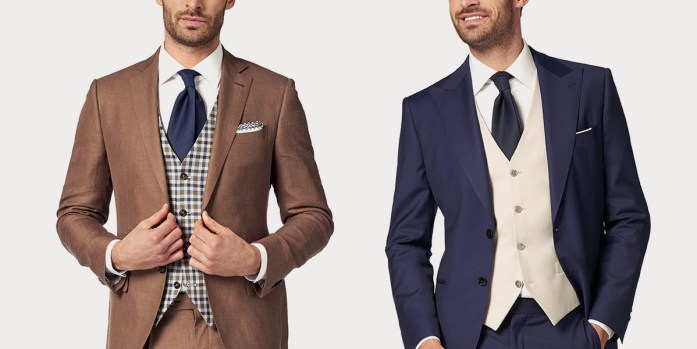 Two man: one in brown suit with prince of wales vest, white shirt and blue tie, and one in blue suit with white shirt, light gray vest and blue tie