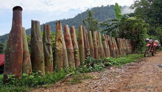 Ho Chi Minh Trail bombie-casings fenceHo Chi Minh Trail bombie-casings fence