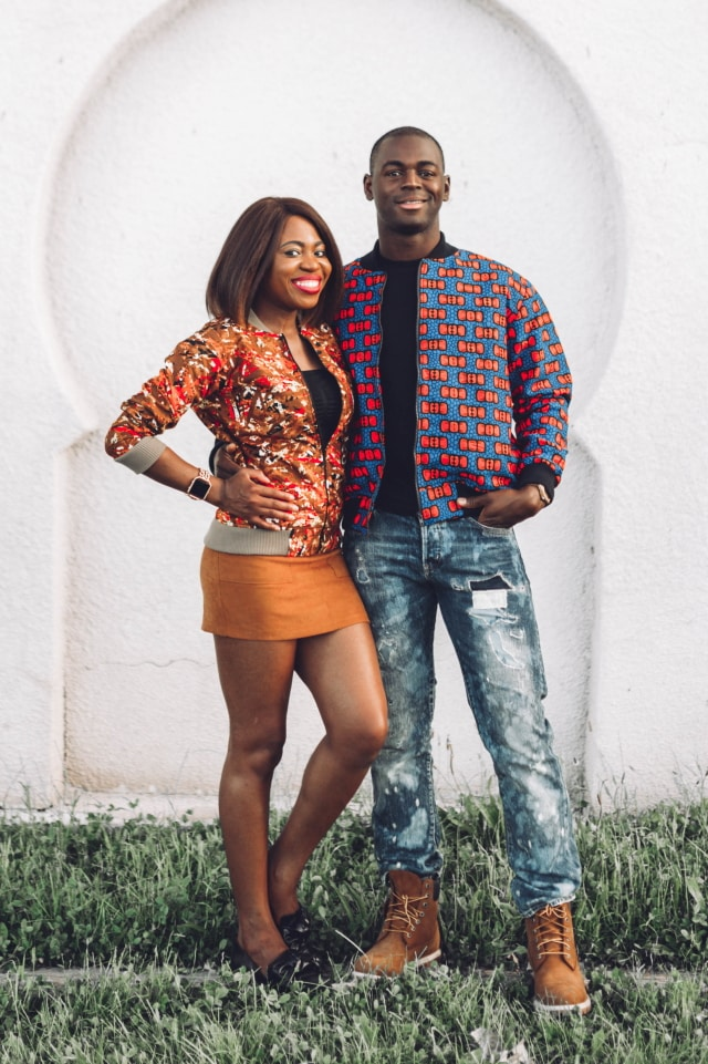 Couple goals! They look so stylish in their African print bomber jacket. ❤️ ❤️ Love how they're subtly matching with her suede mini skirt snd his tan Timberland. Ankara, Dutch wax, Kente, Kitenge, dashiki, ankara bomber jacket, African fashion, African clothing, African prints, Nigerian style, Ghanaian fashion, bomber jacket, Kenya fashion, Nigerian fashion