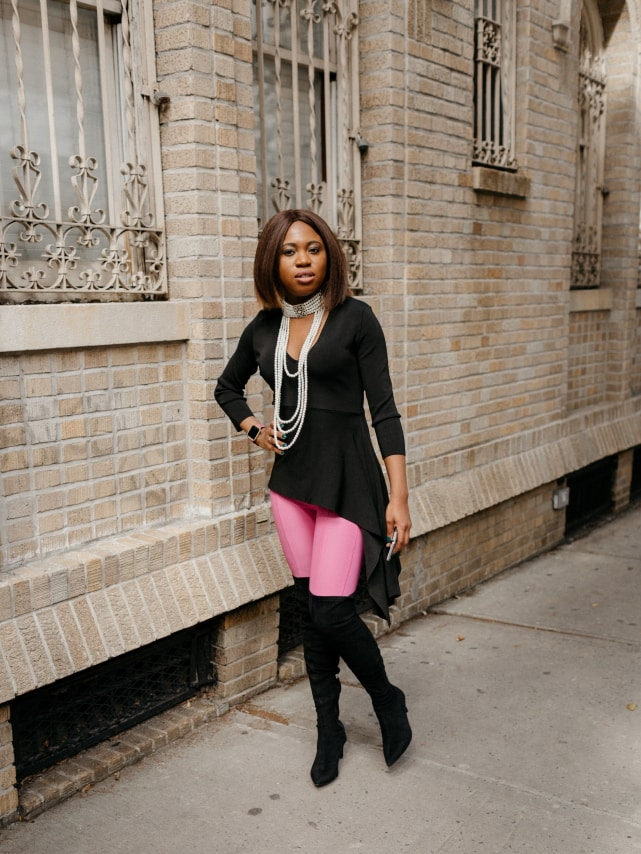 Obsessed with this her pink and black sweater outfit 💕. The suede thigh high boots and statement choker necklace make this fall style crush-worthy. Totally rocking this look soon! #nyfw #sweater #ootd #outfits #fallstyle