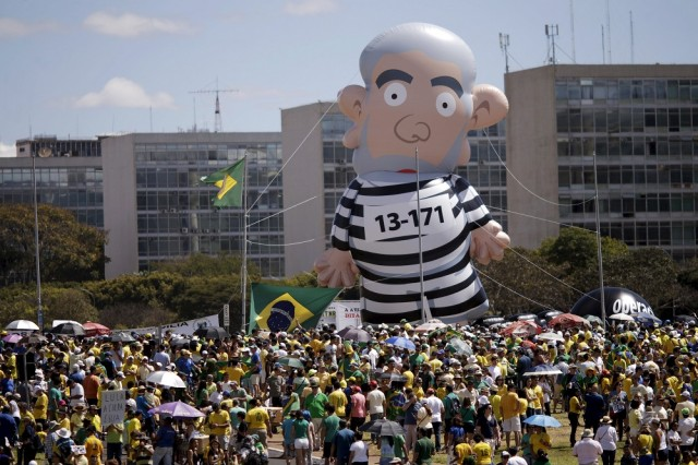An inflatable doll of former President Luiz Inacio Lula da Silva can be seen during a protest against Brazil's President Dilma Rousseff, part of nationwide protests calling for her impeachment, at Esplanade of Ministries in Brasilia, Brazil, August 16, 2015. REUTERS/Ueslei Marcelino
