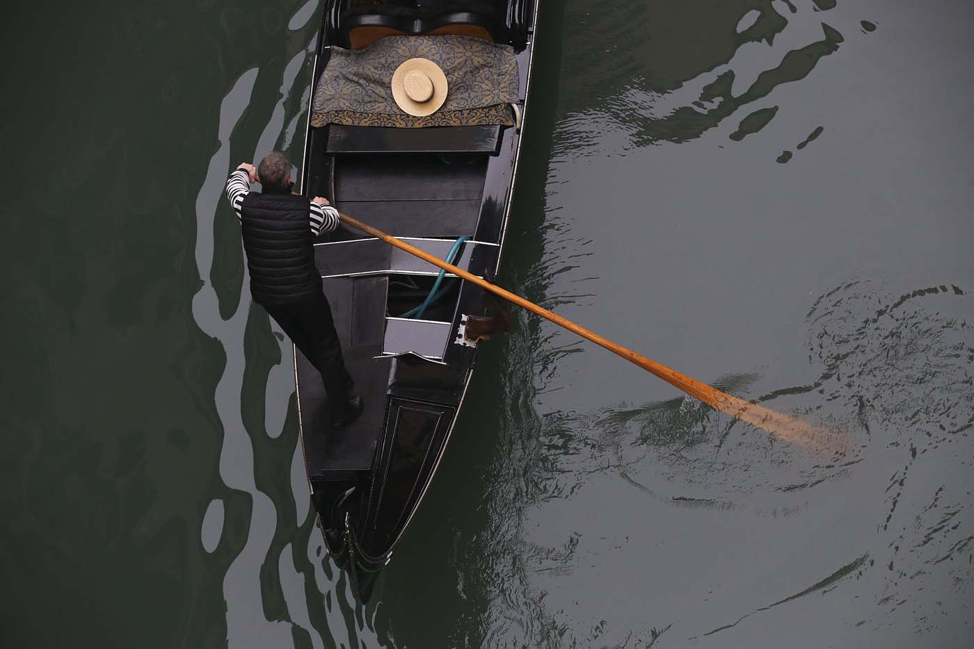A gondolier rows along a canal near St. Mark's Square in Venice January 30, 2016. REUTERS/Alessandro Bianchi