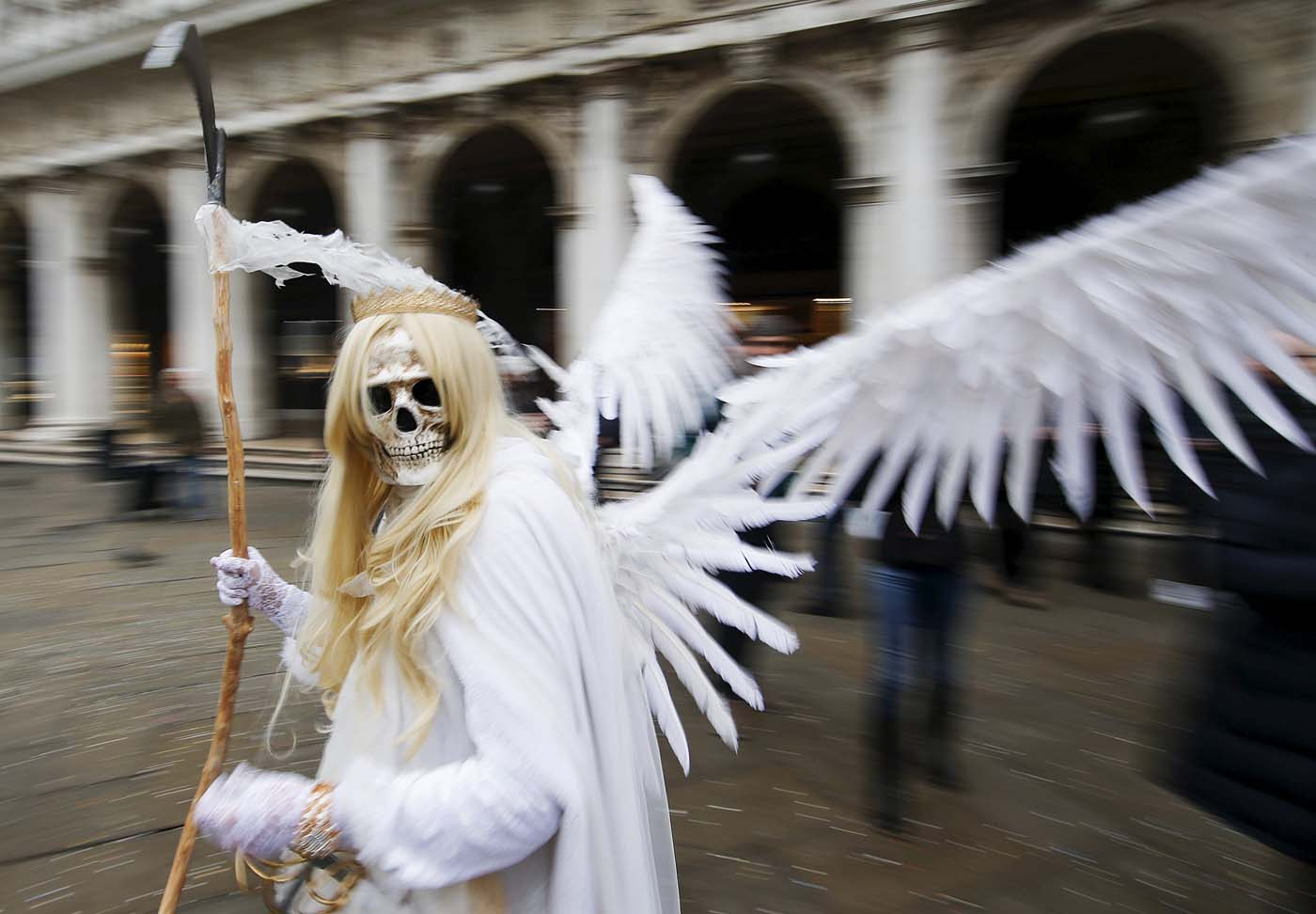 A masked reveller poses in San Marco Piazza during the Venice Carnival, January 30, 2016. REUTERS/Alessandro Bianchi
