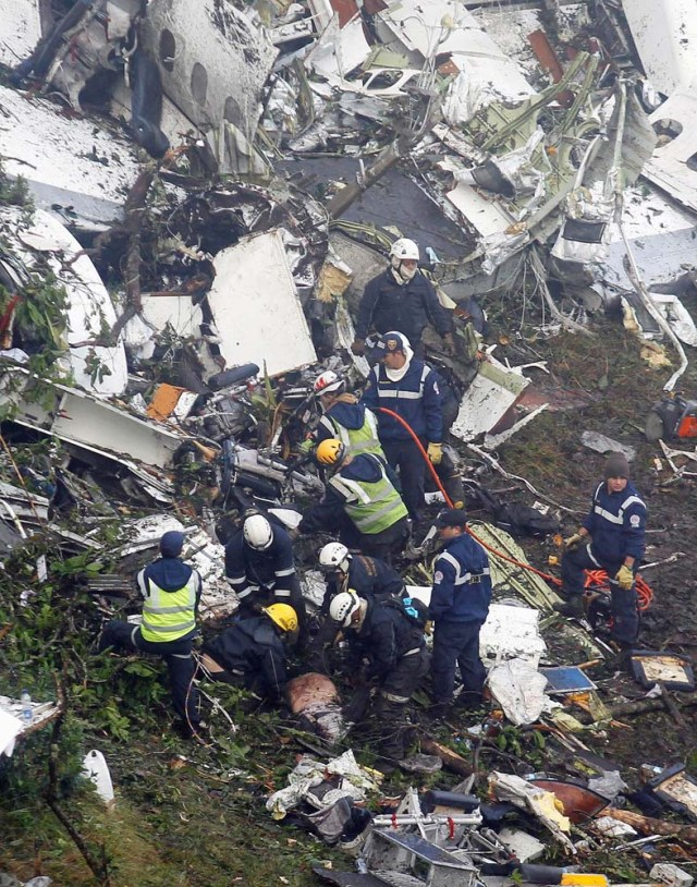 Rescue crew work in the wreckage from a plane that crashed into Colombian jungle with Brazilian soccer team Chapecoense, seen near Medellin, Colombia, November 29, 2016. REUTERS/Fredy Builes
