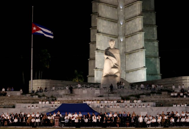 The Cuban flag flies at half-mast as dignitaries gather for a massive tribute to Cuba's late President Fidel Castro in Revolution Square in Havana, Cuba, November 29, 2016. REUTERS/Stringer EDITORIAL USE ONLY. NO RESALES. NO ARCHIVE