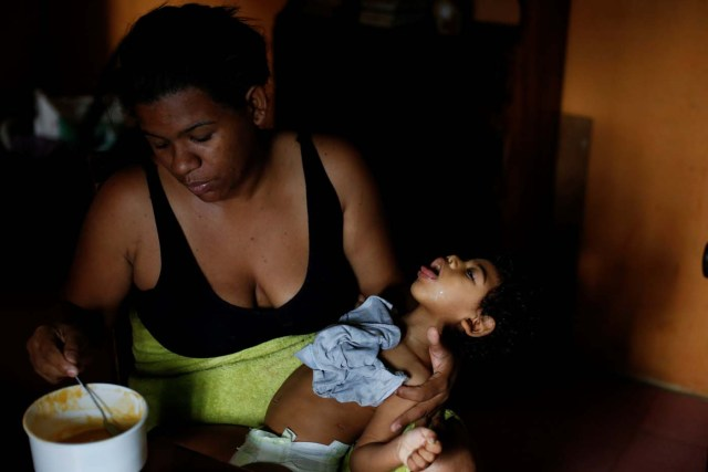 """Tatiana Rocha feeds her son Kaleth Heredia, 2, neurological patient being treated with anticonvulsants, at their house in Caracas, Venezuela February 3, 2017. REUTERS/Carlos Garcia Rawlins SEARCH """"EPILEPSY CARACAS"""" FOR THIS STORY. SEARCH """"WIDER IMAGE"""" FOR ALL STORIES."""