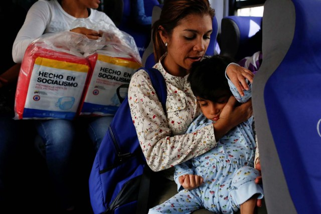 """Norymar Torres carries her son Leonardo Colmenares, 6, neurological patient being treated with anticonvulsants, while they travel on public transport in Caracas, Venezuela January 18, 2017. REUTERS/Carlos Garcia Rawlins SEARCH """"EPILEPSY CARACAS"""" FOR THIS STORY. SEARCH """"WIDER IMAGE"""" FOR ALL STORIES."""