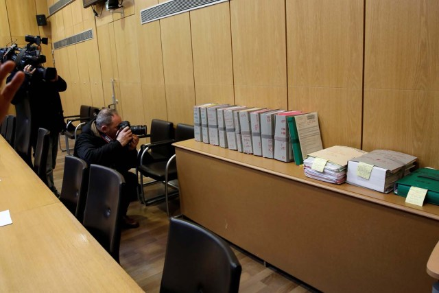 Journalists work in the courtroom before the opening of the trial of Ilich Ramirez Sanchez, known as Carlos the Jackal, in Paris, France March 13, 2017. Carlos the Jackal is appearing in a Paris court for a deadly 1974 attack at a shopping arcade in the French capital, a trial that victims' families have been awaiting for decades. REUTERS/Benoit Tessier