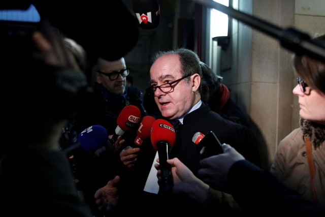"""Georges Holleaux, a lawyer representing the two widows of the men killed and 16 other people affected, talks to journalists before the opening of the trial of Ilich Ramirez Sanchez, known as """"Carlos the Jackal"""", at the courthouse in Paris, France March 13, 2017. Carlos the Jackal is appearing in a Paris court for a deadly 1974 attack at a shopping arcade in the French capital, a trial that victims' families have been awaiting for decades. REUTERS/Benoit Tessier"""