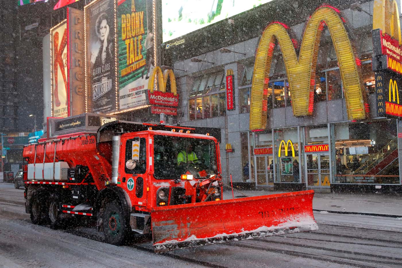 A snow plow drives through Times Square as snow falls in Manhattan, New York, U.S., March 14, 2017. REUTERS/Andrew Kelly