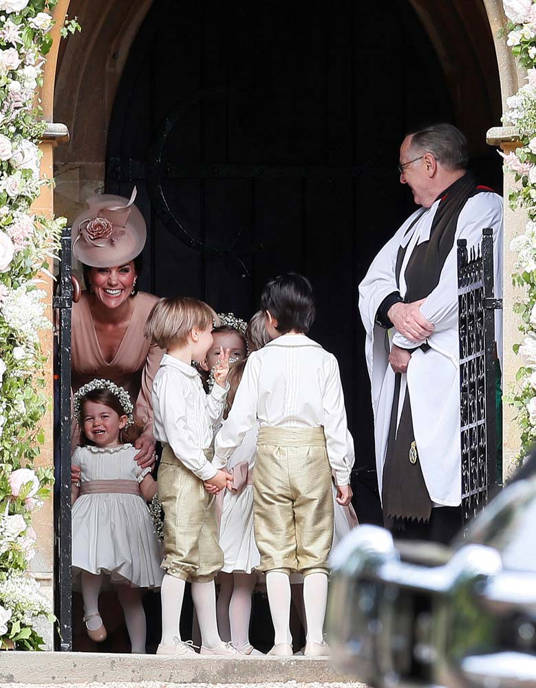 Britain's Catherine, Duchess of Cambridge (L), stands with her daughter Princess Charlotte, (BOTTOM L), as they arrive for the wedding of Pippa Middleton and James Matthews at St Mark's Church in Englefield, west of London, on May 20, 2017. REUTERS/Kirsty Wigglesworth/Pool
