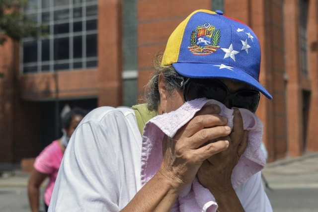 "An opposition demonstrator is affected by tear gas in clashes with the riot police during the ""Towards Victory"" protest against the government of Nicolas Maduro, in Caracas on June 10, 2017.  Clashes at near daily protests by demonstrators calling for Maduro to quit have left 66 people dead since April 1, prosecutors say.  / AFP PHOTO / LUIS ROBAYO"