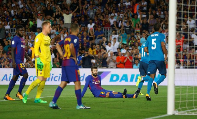 Soccer Football - Barcelona v Real Madrid Spanish Super Cup First Leg - Barcelona, Spain - August 13, 2017 Barcelona's Gerard Pique looks dejected after scoring an own goal and the first for Real Madrid REUTERS/Juan Medina