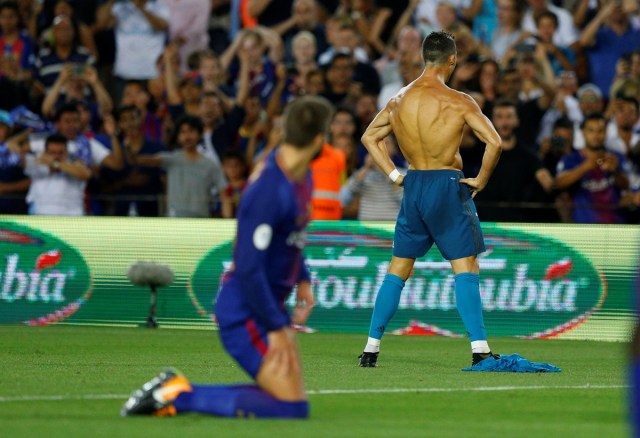 Soccer Football - Barcelona v Real Madrid Spanish Super Cup First Leg - Barcelona, Spain - August 13, 2017   Real Madrid's Cristiano Ronaldo celebrates scoring their second goal and is later booked for removing his shirt   REUTERS/Juan Medina