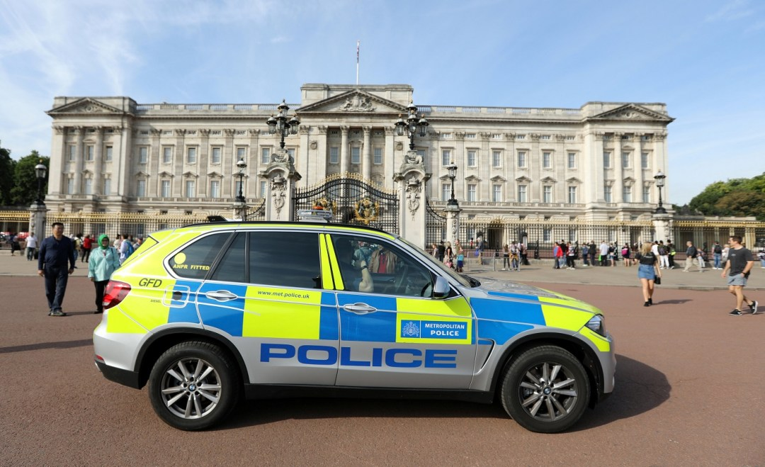 A police vehicle patrols outside Buckingham Palace in London, Britain August 26, 2017. REUTERS/Paul Hackett
