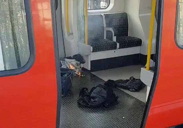 REFILE - CORRECTING TYPO Personal belongings and a bucket with an item on fire inside it, are seen on the floor of an underground train carriage at Parsons Green station in West London, Britain September 15, 2017, in this image taken from social media.   SYLVAIN PENNEC/via REUTERS  THIS IMAGE HAS BEEN SUPPLIED BY A THIRD PARTY. NO RESALES. NO ARCHIVES. MANDATORY CREDIT