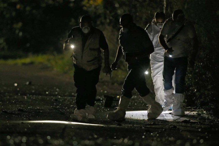 Forensic experts use lights as they look for evidence on a road near a field after a powerful bomb blew up a car and killed investigative journalist Daphne Caruana Galizia in Bidnija, Malta, October 16, 2017. REUTERS/Darrin Zammit Lupi