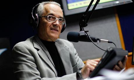 Reporter Bocaranda talks during his radio program in Caracas
