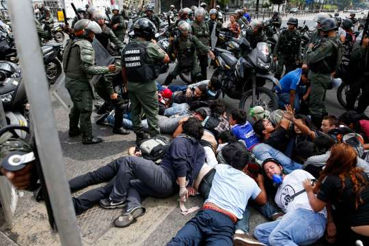 National guards detain a group of anti-government protesters during a protest against Venezuelan President Maduro's government in Caracas