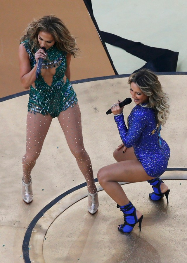 Claudia Leitte and Jennifer Lopez perform during the 2014 World Cup opening ceremony at the Corinthians arena in Sao Paulo