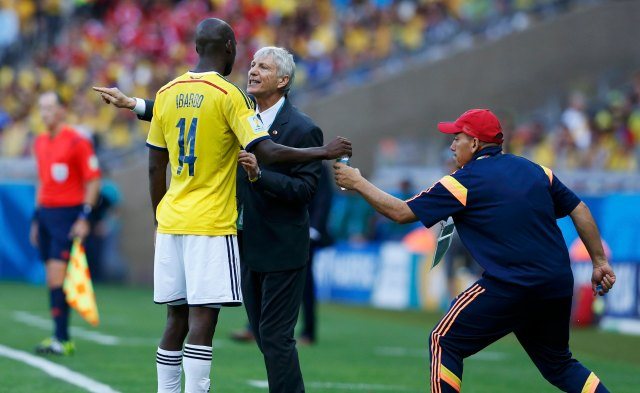 Colombia's Ibarbo takes a drink as he receives instructions from coach Jose Pekerman during their 2014 World Cup Group C soccer match against Greece at the Mineirao stadium in Belo Horizonte