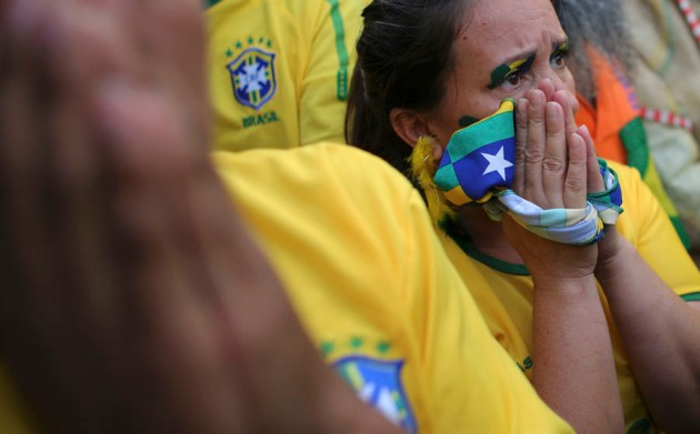 A Brazilian soccer fan reacts as she watches the 2014 World Cup semi- final soccer match between Brazil and Germany in Sao Paulo